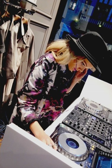 Becca spins the decks at a fashion party